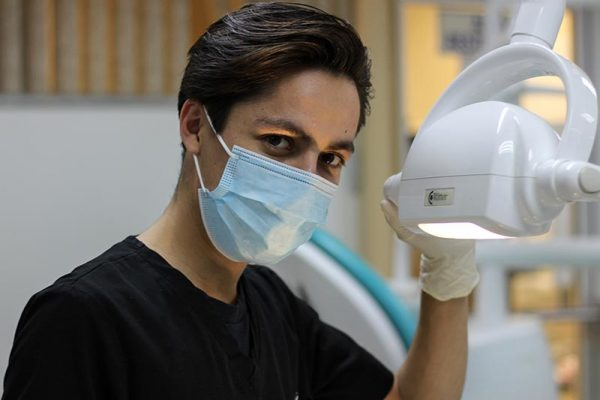 Male dentist in mask